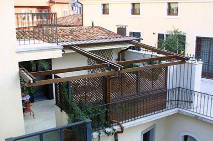 Grigliati in legno su misura a ravenna da giardini per balconi e